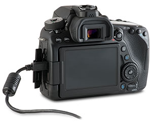 Canon 80D camera with USB cable in side port and open door
