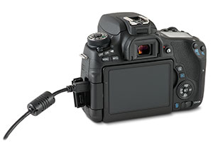 Canon T6s camera with USB cable in side port and open door