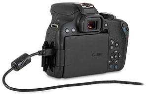 Canon T7i camera with USB cable in side port and open door