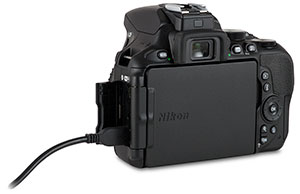 Nikon D5600 USB cable to camera port with door open