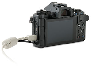 Olympus E-M5 II camera USB port with cable and door open