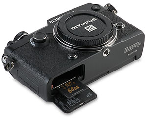 Olympus PEN-F SD card door open with memory card in slot